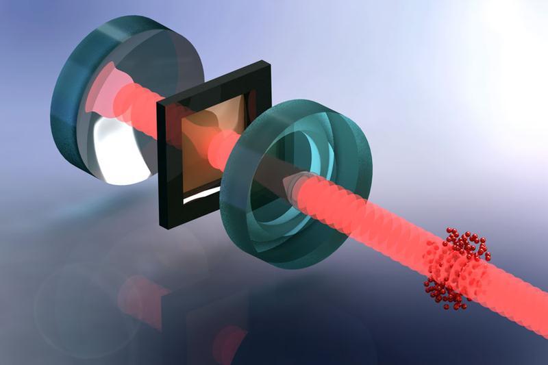 ine Wolke von ultrakalten Atomen (rot) wird zur Kühlung der mechanischen Schwingungen einer millimetergrossen Membran (braun, in schwarzem Rahmen) verwendet. Quelle: Tobias Kampschulte, Universität Basel (idw)