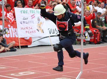 Feuerwehr Herrenberg-Kuppingen (BW) beim Traditionellen Internationalen Feuerwehrwettbewerb im Rahmen der alle vier Jahre stattfindenden Wettbewerbe des Weltfeuerwehrverbandes CTIF