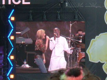 Dido performing with Youssou N'Dour in Hyde Park, London.
