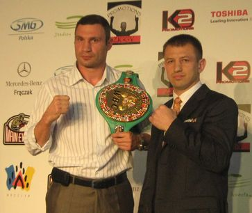 Vitali Klitschko and Adamek, during signing for the fight in 2011
