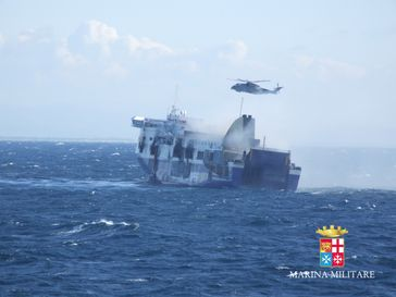 Norman Atlantic on fire, with rescue efforts underway. Photo from the Italian Navy.