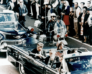President Kennedy with his wife, Jacqueline, and Governor of Texas John Connally in the presidential limousine, minutes before the President's assassination