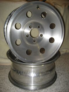 Forged aluminum wheels. Made by Alcoa with their typical design.