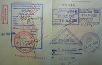 Verschiedene Sichtvermerke (Visa) und andere Kontrollstempel in einem deutschen Reisepass