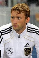 Rolfes with Germany in 2011