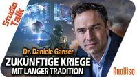 """Bild: Screenshot Video: """"Zukünftige Kriege mit langer Tradition - Dr. Daniele Ganser im NuoViso Talk"""" (https://youtu.be/IEXoe5yJYK8) / Eigenes Werk"""