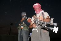 Pair of armed anti-American insurgents from northern Iraq
