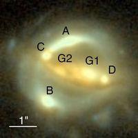 """Das Gravitationslinsensystem B1608+656, aufgenommen mit der """"Advanced Camera for Surveys"""" an Bord des Hubble Space Teleskops. Die Bilder der Quellgalaxie sind hier mit A-D bezeichnet, die beiden Linsengalaxien mit G1 und G2. © NASA/STScI, ESA, S. H. Suyu (University of Bonn), P. J. Marshall (Stanford University)"""