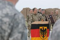 International Security Assistance Force Chief of Staff German Army Lt. Gen. Bruno Kasdorf, speaks before presenting the German Gold Cross of Honor medal to pilots and crew members of a U.S. air medevac unit, 5th Battalion, 158th Aviation Regiment, Katterbach, Germany, on May 12 at Provincial Reconstruction Team Kunduz. The German Gold Cross Medal, had never been awarded to foreign troops before. They were honored for their bravery evacuating wounded German Soldiers while under fire near Kunduz on April 2.(Photo by U.S. Army SFC Matthew Chlosta, ISAF PAO).