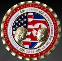 A commemorative coin prepared by the White House Communications Agency for the summit