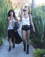 Cyrus walking into a studio, June 2012