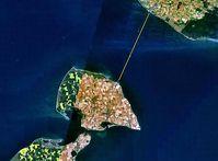 Satellitenbild mit Fährroute der Vogelfluglinie über den Fehmarnbelt. Bild: NASA / de.wikipedia.org