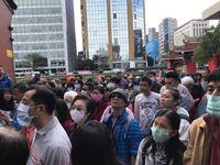 Leute mit Mundschutz in Taiwan, wegen des Coronavirus