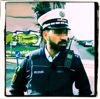 Polizist mit Migrationshintergrund (Symbolbild)