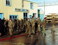 Soldiers from the Parachute Regiment guard Argentine prisoners of war during the Falklands War.