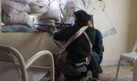 A Syrian rebel sniper in Khan al-Asal, Aleppo Governorate.