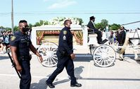 The carriage carrying Floyd's casket to his burial in Pearland, Texas, June 9