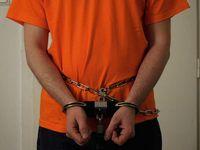 Gefangener in Handschellen (Symbolbild)