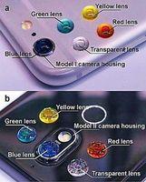 Bunte Linsen: Polymere auf der Handy-Kamera.