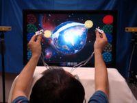 """Die Welt in Händen: """"i³Space"""" vermittelt Berührungsgefühl. Bild: aist.go.jp"""