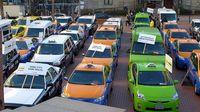 Protest von Taxifahrern gegen die Verschiedenheit der Regulierung von Taxis und der Regulierung der Uber-Konkurrenz, in Portland, USA, 2015