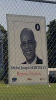 Wahlplakat von Michel Martelly Bild: Marcello Casal Jr / de.wikipedia.org