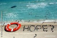 Aktivisten formen eine Hoffnungsbotschaft am letzten, entscheidenden Tag der Klimaverhandlungen in Cancún. / Bild: greenpeace.de